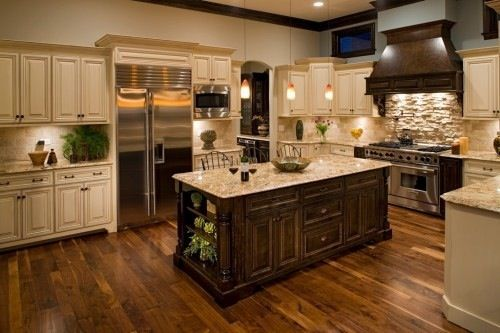 I love the off white cabinets with the darker wood on the island, but I would but darker countertops under the cabinets.