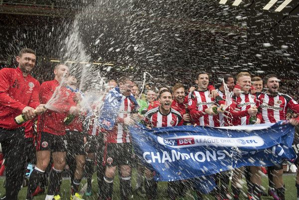 SHEFFIELD, ENGLAND- APRIL 17: Sheffield United players celebrate winning promotion to the Sky Bet Championship after the Sky Bet League One match between Sheffield United and Bradford City at Bramall Lane on April 17, 2017 in Sheffield, England.