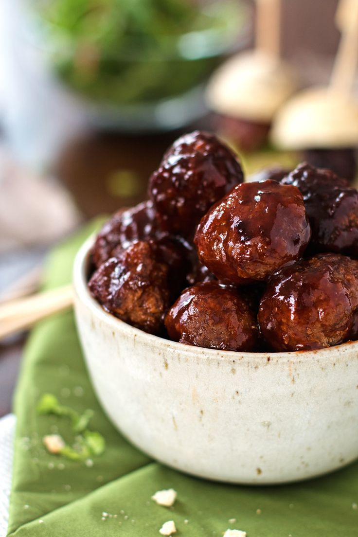 This recipe for Sticky BBQ Slow Cooker Meatballs uses barbecue sauce to make a delicious homemade party appetizer! They are easy to make as the crockpot does most of the work for you! Serve them on their own or as mini subs - they are going to be a big hit either way!