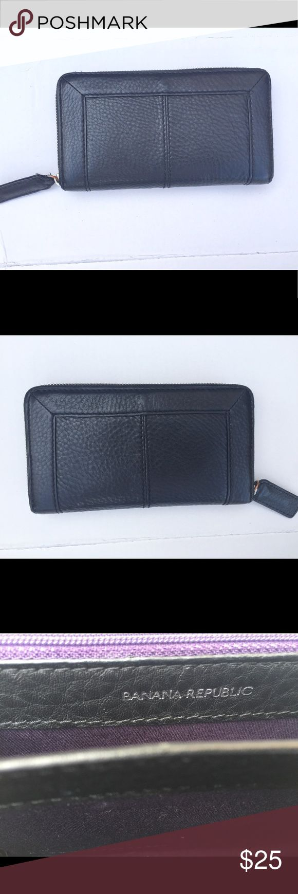 BLACK LEATHER BANANA REPUBLIC WALLET Black leather Banana Republic zip wallet. No signs of wear! Comes with 12 card slots and a zip compartment for coins. Original purchase price is currently unknown. Banana Republic Bags Wallets