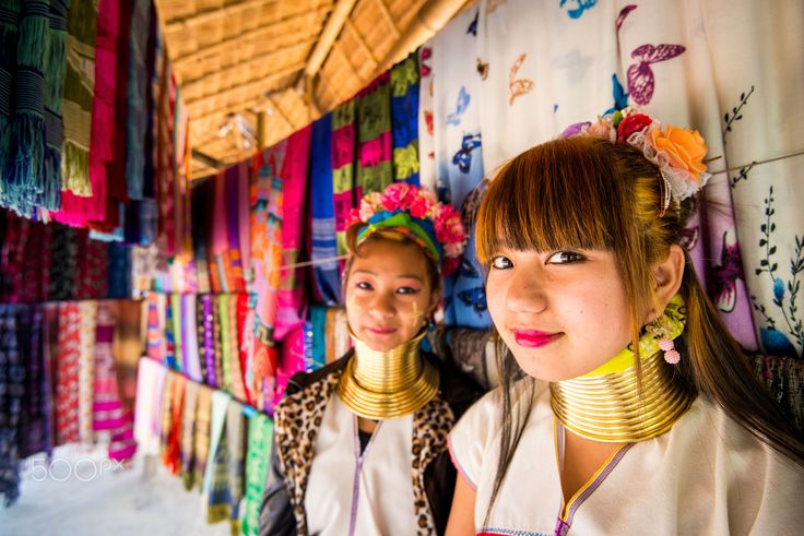 Long neck beauty - Two young girls from the Karin ethnic tribe photographed in a small village mountain in Chiang Rai, Thailand.