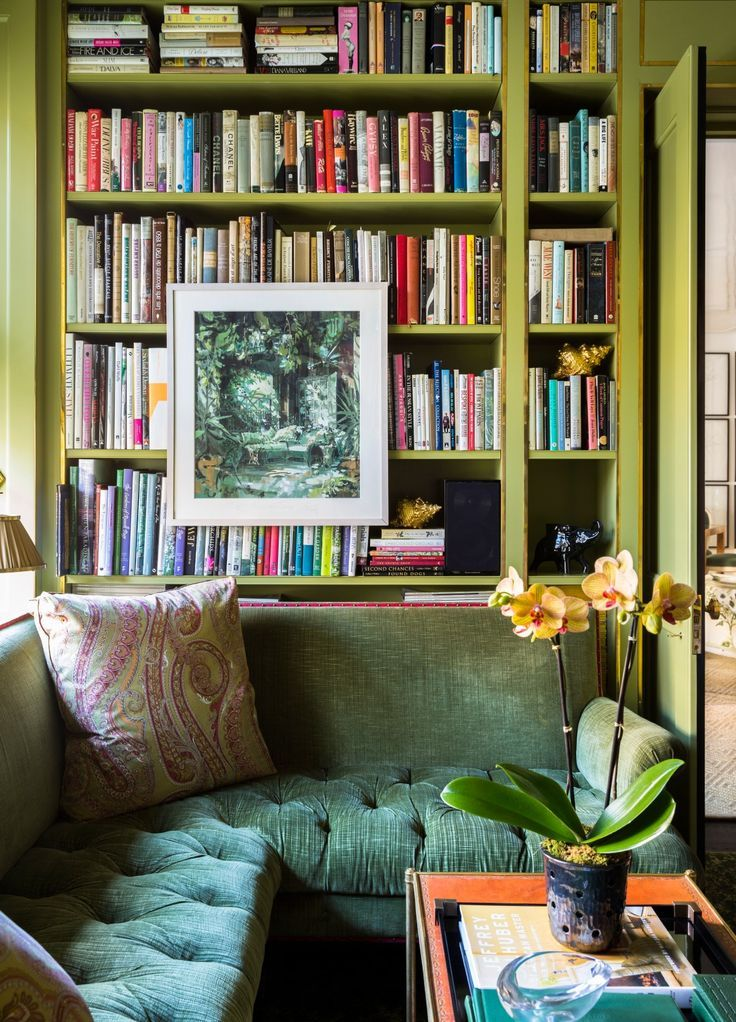 This cozy library corner gets an extra dose of regal style from the lush green tufted velvet built-in window seat.