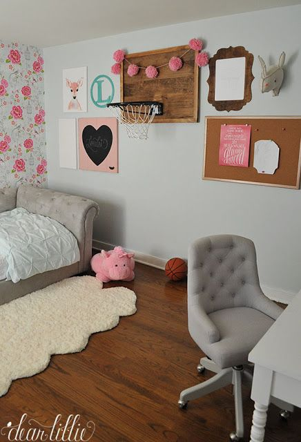 This gallery wall isn't quite finished but the wooden basketball hoop is such a fun addition to a kid's room and the pink pom poms add a fun girly twist. The pink heart chalkboard and cute little unicorn from HomeGoods add some whimsical touches to the space and the tufted daybed and desk chair can transition into a more grown up looking space as she gets older. (sponsored pin)