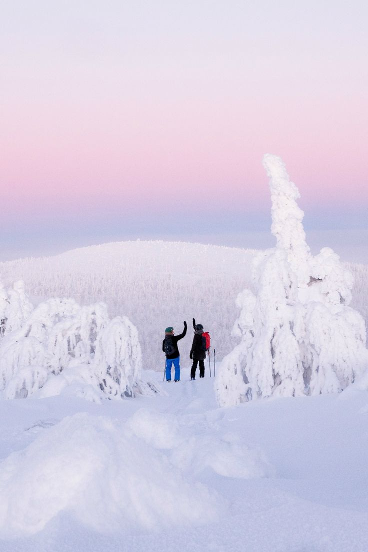 Hight five friends, winter hiking, skiing photography. Pink sky blue moment, winter nature photography. Simple living lifestyle inspiration.