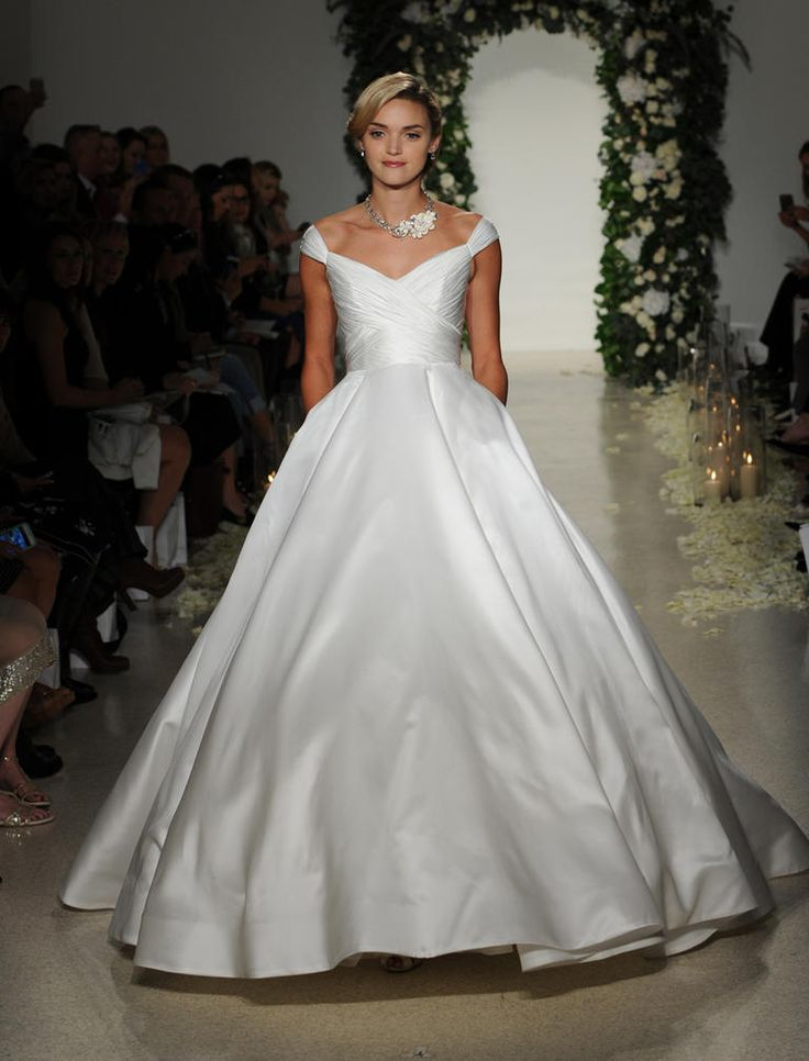 Anne Barge Fall 2016 ball gown with off-the-shoulder neckline, ruched bodice and A-line skirt | https://www.theknot.com/content/anne-barge-wedding-dresses-bridal-fashion-week-fall-2016