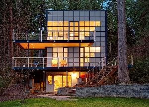 Quiet cove on Beaver Lake with a 56-foot private beach; sun-soaked 1290 sq ft 3-story AIA award-winning-architect-designed glass home.