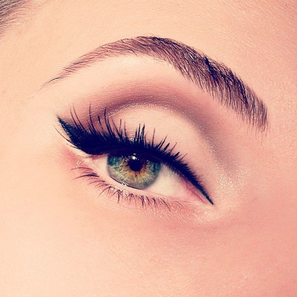 Lovely subtle cat eye action with killer lashes.