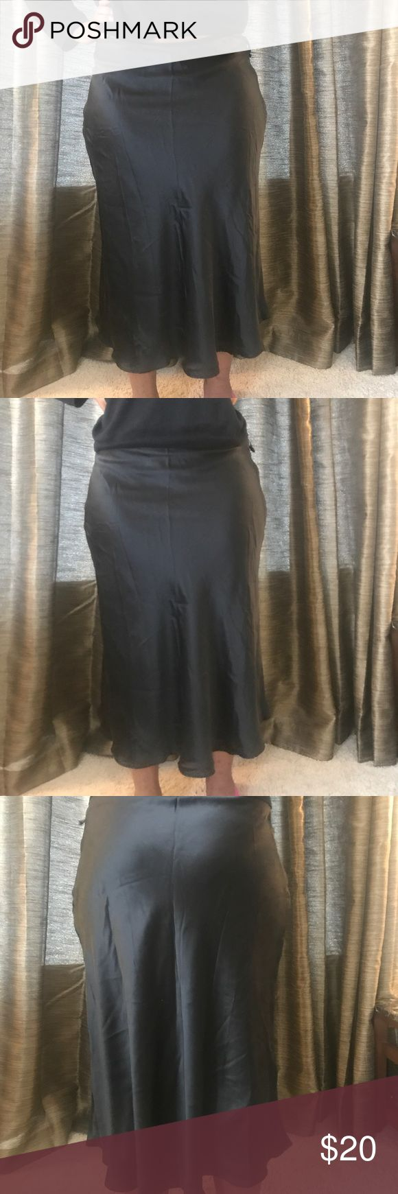Beautiful fit and flare skirt. Beautiful fit and flare skirt. Size 14. 100 percent silk. Jaclyn Smith Skirts A-Line or Full
