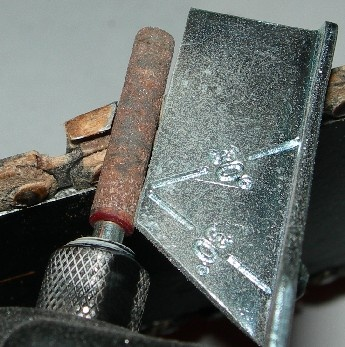 How to sharpen a chain saw using Dremel's Chain Saw Sharpening Kit.finally a pin for the hubby.