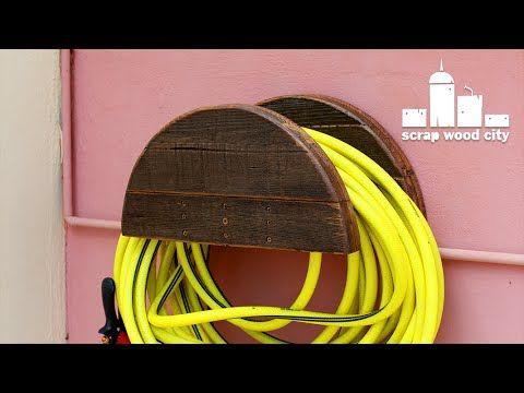 Awesome DIY Garden Hose Hanger Out Of Pallet Wood