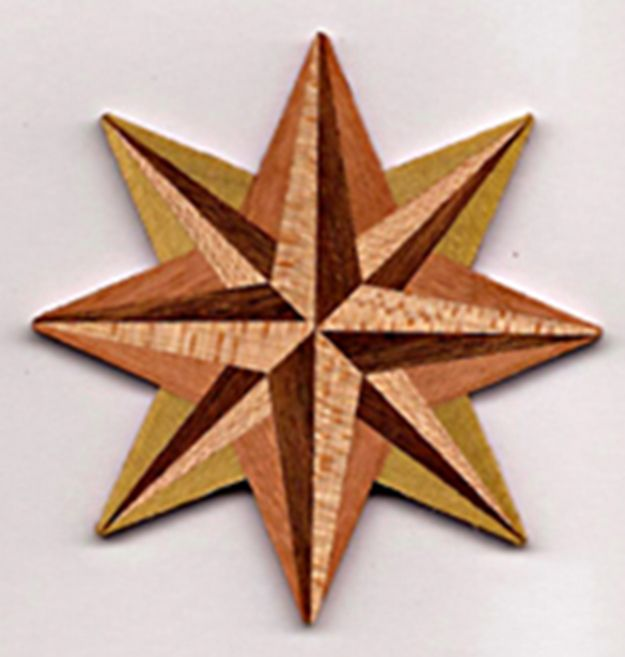 SOLD OUT 12/14/17:, avail. by special order.  KM1015, $18.00; fine, handcrafted ornament, made in the USA.  Eight-point star; wood tones may vary; each piece  is unique.  Ribbon hanger incld.