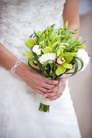 bridesmaid bouqette- fun  http://cache.elizabethannedesigns.com/blog/wp-content/uploads/2012/03/Green-Orchid-Lisianthus-Bouquet-300x451.jpg