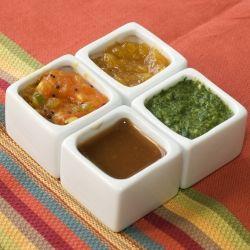 Four types of Indian chutneys - Mango Chutney, Tomato Chutney, Mint Cilantro Chutney and Tamarind Chutney