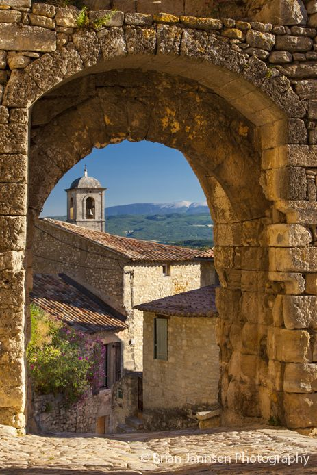 View through medieval gate toward Mont Ventoux in Lacoste, Provence