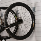 Bike storage on the wall prevents damage and provides easy access to multiple bikes with a J-hook by storeWALL