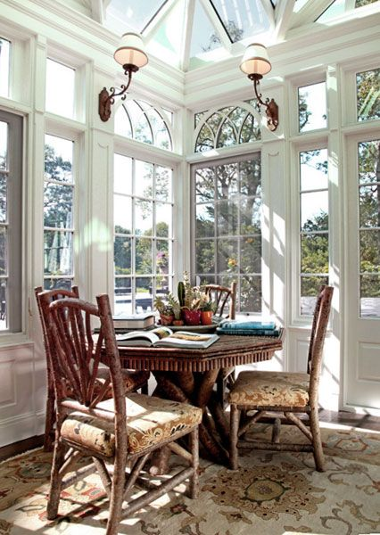 Cheery sunroom dining by Andrew Maier Interiors, Locust Valley, NY - rustic  furniture by