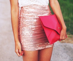 Pink metallic skirt with statement pink clutch for an accessory.