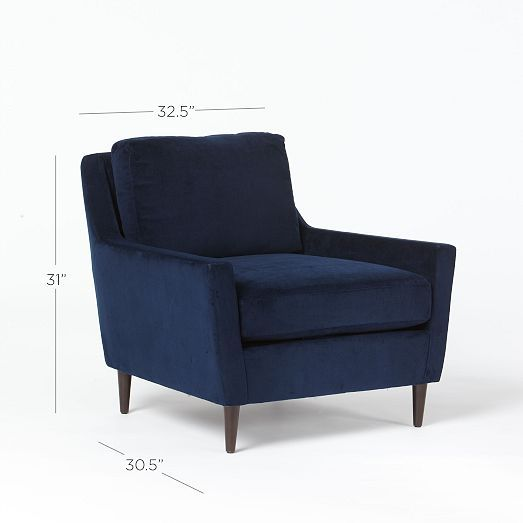 A pair of Everett Armchairs from West Elm upholstered in navy velvet fabric.