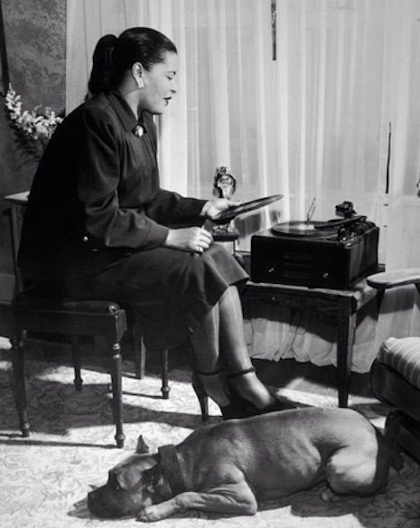 Bille Holiday, her pitbull Mister and her turntable, 1945                                                                                                                                                                                 More