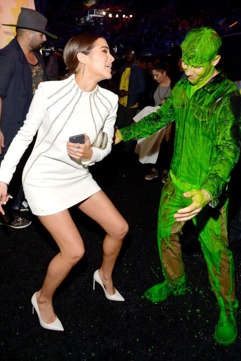 Nick Jonas tries to hug girlfriend Olivia Culpo after getting slimed during Nickelodeon's 28th Annual Kids' Choice Awards. (She's NOT having it)
