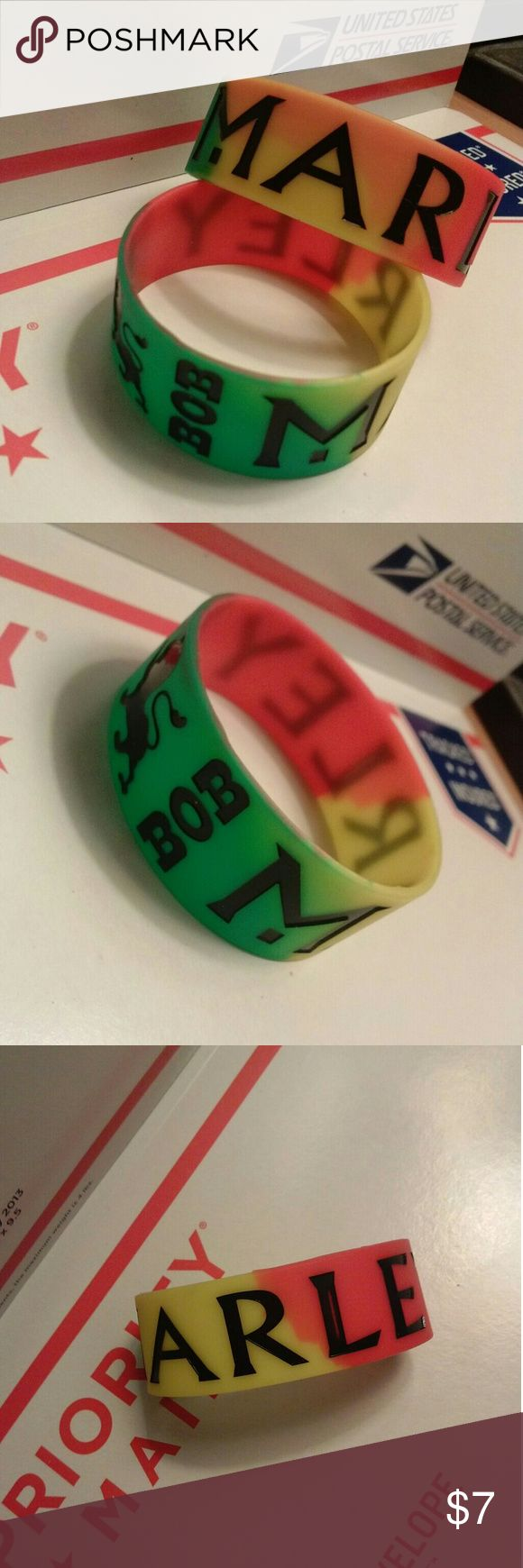 (2) BOB MARLEY BRACELETS RASTA COLORS WRIATBANDS TWO WRISTBANDS. NEW.NEVER USED. YOU RECEIVE BOTH.   ONE SIZE FITS MOST ADULTS BLENDED GREEN YELLOW AND RED COLORS STRONG DURABLE THICK SILICONE Accessories Jewelry