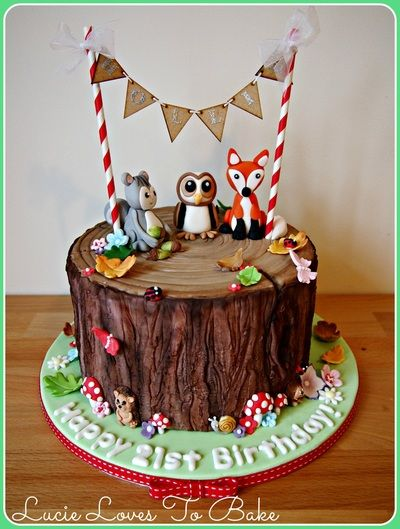 Painted wood tree stump cake with woodland animals and bunting! Handmade by Lucie at #lucielovestobake - www.lucielovestobake.com (Cake maker and decorator in Aylsham, north of Norwich specializing in beautiful bespoke cakes and cupcakes for weddings and all special occasions in Norfolk)
