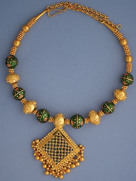 22k Gold square necklace with green enamel This Green necklace is fresh & creatove. This necklace has a square pendant with green enamel. The chain of the necklace has balls with granulated design. If gifted, it is a gift with distinction #22k, #Gold, #Green, #Square, #Necklace,