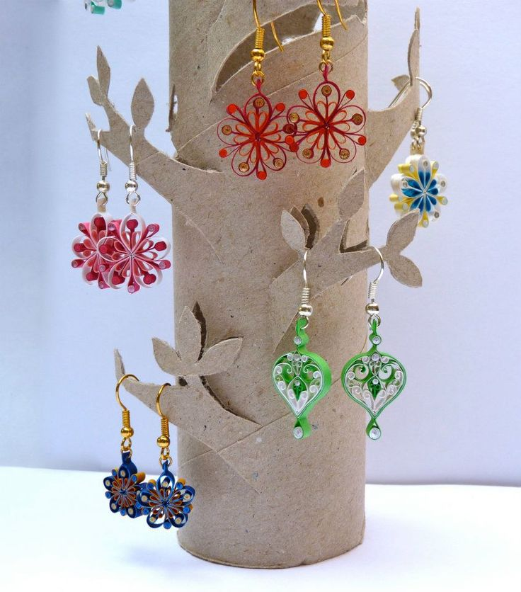 Earring tree display, using an inner tube from kitchen roll. It would look nice covered in appropriate paper before cutting.