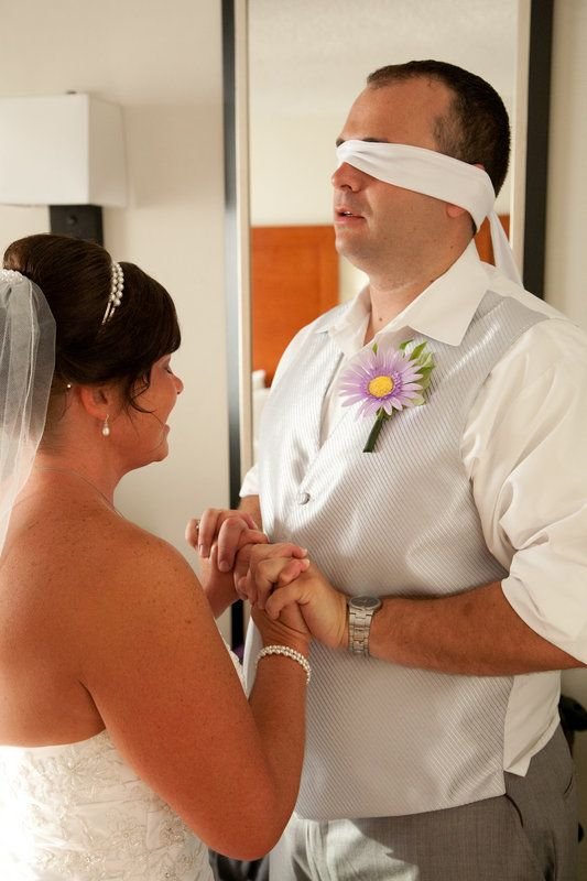 Wedding couple pre-ceremony prayer; blindfolded groom; first look; Photo By Nicole Hanson Photography