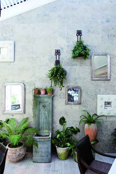 An indoor garden and living gallery wall is just one of the highlights at Belmond Charleston Place's light-filled Palmetto Cafe. Click through for Lonny's complete guide to Charleston, South Carolina. | Lonny