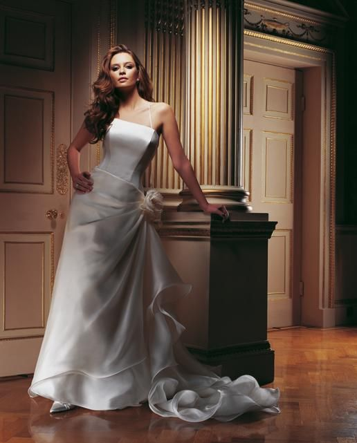Carlotta  For the bride searching for the wow factor. Elegant duchess satin bodice with organza wired skirt.