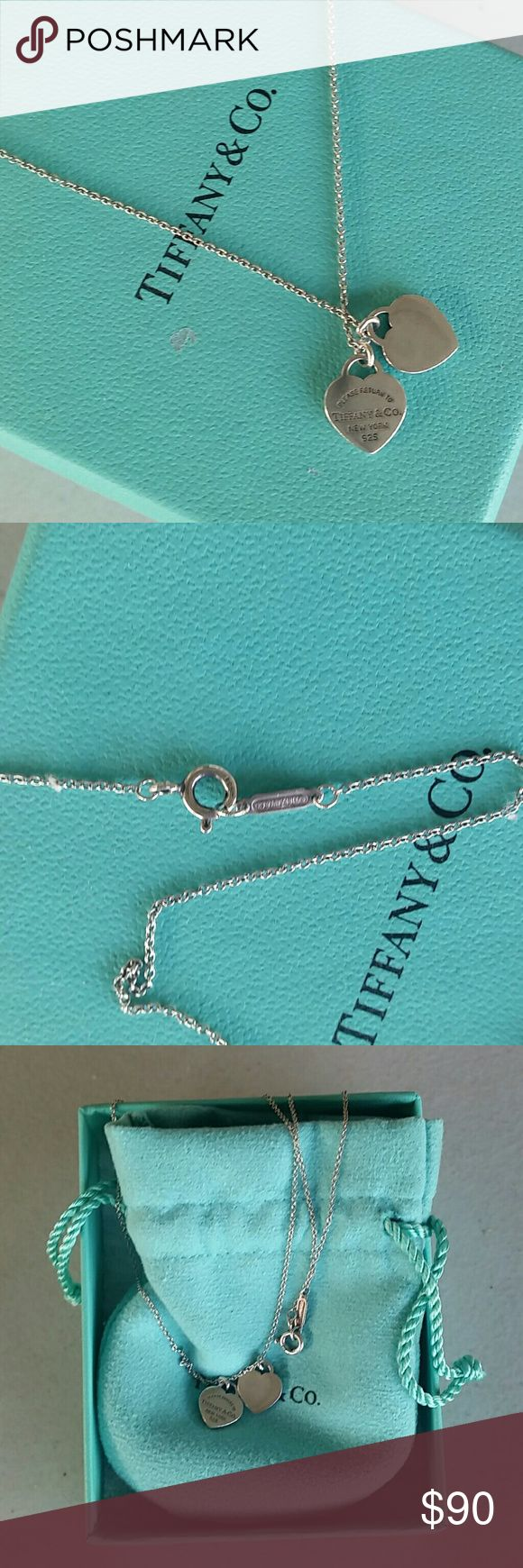Tiffany & Co Double Heart Necklace Sterling silver! Beautiful necklace but this is from an ex so it's time to go. ?????? Comes in original box and pouch, purchased from the Ala Moana  (Hawaii) Tiffany Store. Tiffany & Co. Jewelry Necklaces