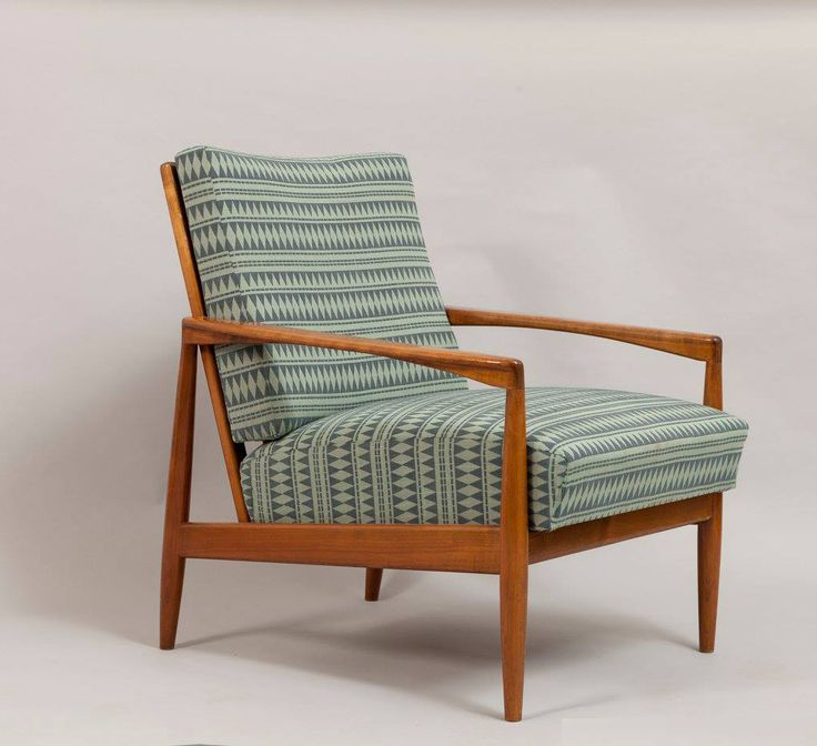 Circa 1950  This rare teak paper-knife armchair was designed by Kai Kristiansen and produced by Magnus Olesen in Denmark in the 60s. It featured a polished frame and new upholstery, that can be changed upon request with the client's fabric.  SOLD