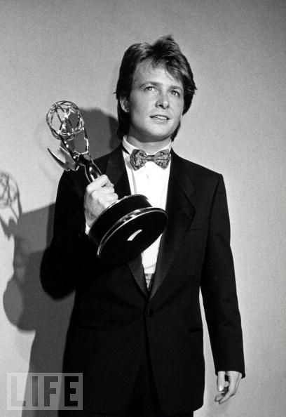Family Ties star Michael J. Fox hoists his Emmy in 1987. He won three Emmys for playing Alex, the Republican son of ex-hippie parents, on the hit sitcom.
