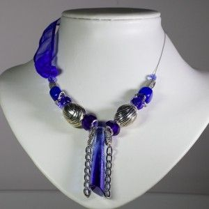 Unique, rich and elegant blue Swarovski pendant necklace with silver beads and a touch of blue fabric