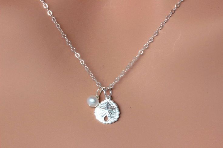 Sand Dollar necklace, sand dollar Necklace, beach wedding, simple everyday jewelry,  Everyday Necklace, Sand Dollar, Layering Necklace by rainbowearring on Etsy https://www.etsy.com/listing/200120322/sand-dollar-necklace-sand-dollar