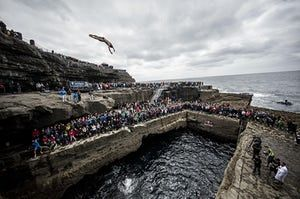 Inis Mor, Ireland. David Colturi of the USA dives from the 27.5-metre platform at the Serpent's Lair during the first stop of the Red Bull Cliff Diving World Series which took place over the weekend
