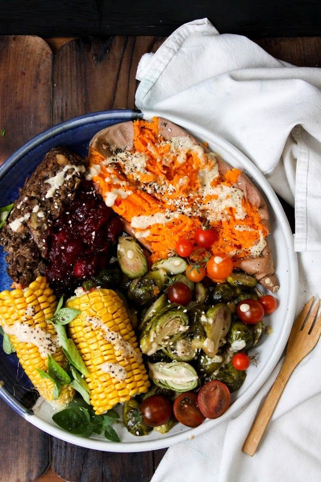 baked yams, steamed corn and pepper garlic brussels sprouts with mushroom nut loaf, tahini ginger miso gravy and orange cranberry sauce