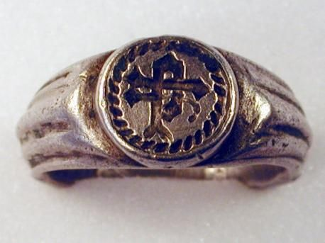 """1400s-1500s: The initials look like """"hP"""" to me, as in the Lordship of Hellifield Peel in the North Yorkshire Dales, owned by the Hamerton family in the 15th & 16th century.  Author Philip G. Hamerton was a distant cousin. ring unearthed by Edwin Booth in his Birstall, West Yorkshire garden.   It has a 25mm diameter, fluted shoulders terminating with a beaded circular bezel, marked with initials."""