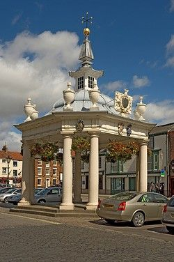 The ornate Market Cross in Saturday Market, erected in 1714 , and bearing 4 shields of the arms of the families who gave money to help build it. Beverley, Yorkshire, England
