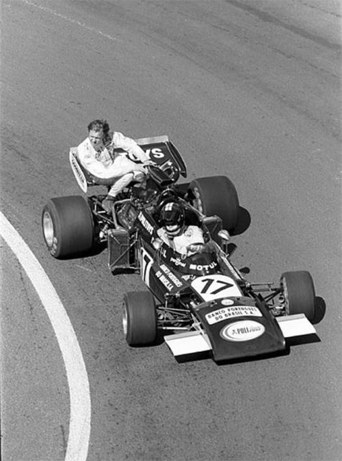 Awesome: Carlos Pace getting a ride on Ronnie Petersons March 721, during the practice for the 1972 French Grand Prix.