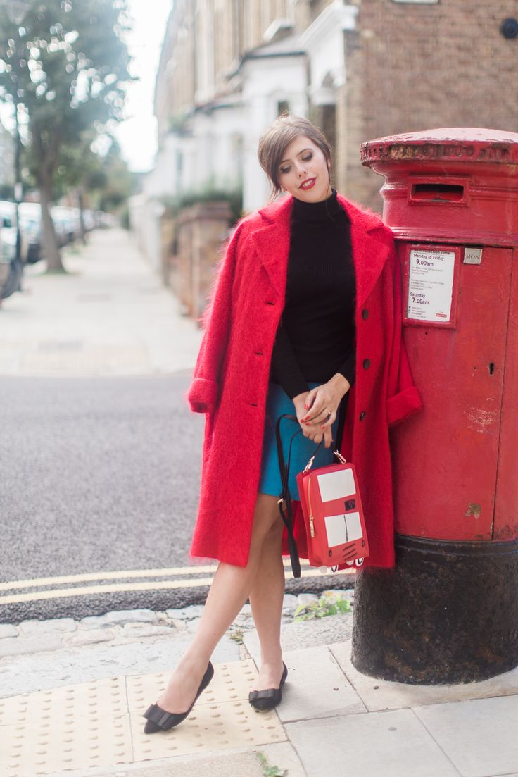 A mid-century take on 'lady in red.' Carrie pairs the Boden black roll neck, Vintage Button Skirt and Audrey Flats with The Spitalfields Coat - a limited edition creation from the Boden ICONS range. Take a closer look > http://blog.boden.co.uk/bloggers-icons-party/