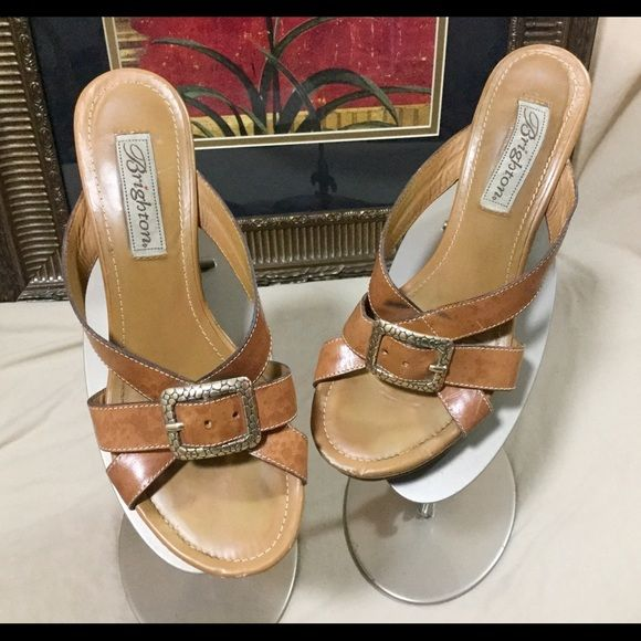 "Nice Brighton Sandals Sz 7 These sandals are awesome.  They have some wear to them but they are awesome.  Here little wear on the front and where the buckle lies on the shoe.  So,  when you wear them you can't see it.  Sz7. Heel height 2.5"". Platform little over an inch. Brighton Shoes Sandals"