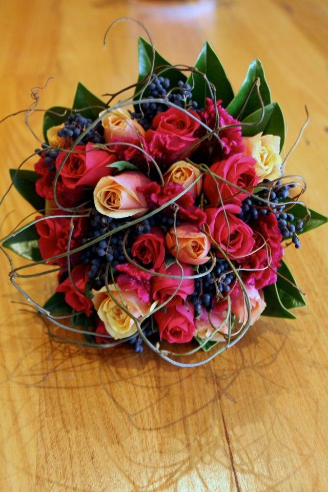 Hot pink & tango roses, hot pink celosia, blue privet berries, with magnolia leaves & doda vine #weddings  http://www.RedEarthFlowers.com.au/
