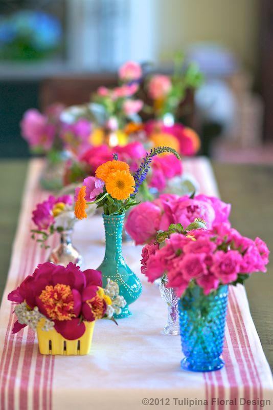 BRIGHT flowers + a mix of vintage vases.