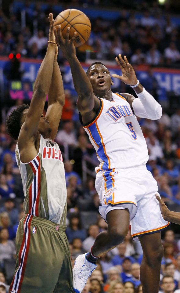Oklahoma City's Victor Oladipo (5) shoots against Miami's Josh Richardson (0) during an NBA basketball game between the Oklahoma City Thunder and the Miami Heat at Chesapeake Energy Arena in Oklahoma City, Monday, Nov. 7, 2016. Photo by Nate Billings, The Oklahoman
