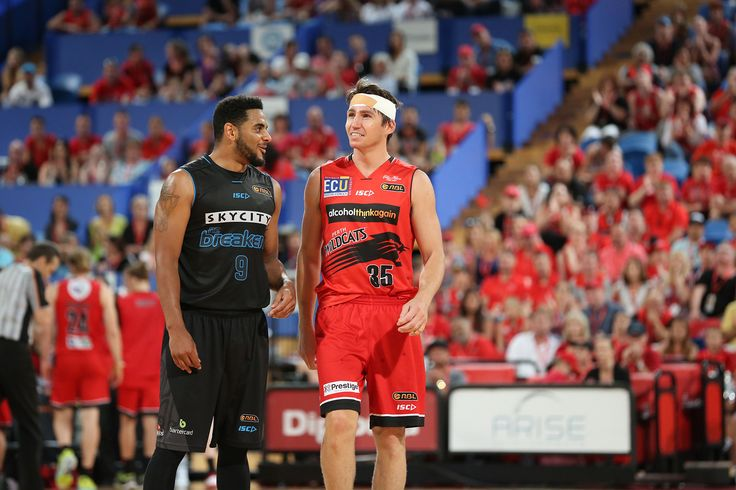 A bandaged-up Damian Martin chats with NZ's Corey Webster while wearing a replacement uniform in a bloody, double-overtime thriller against the eventual Champions. Photo Michael Farnell/Perth Wildcats