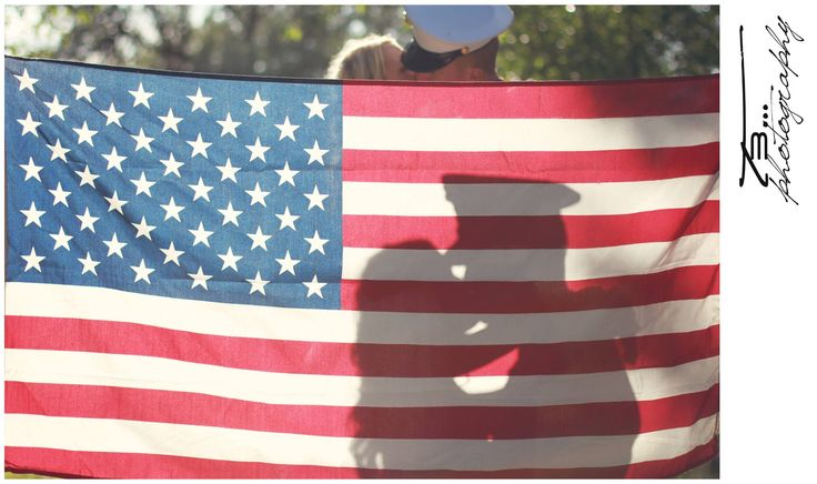 Military wedding - American flag - silhouette - kissing behind the flag