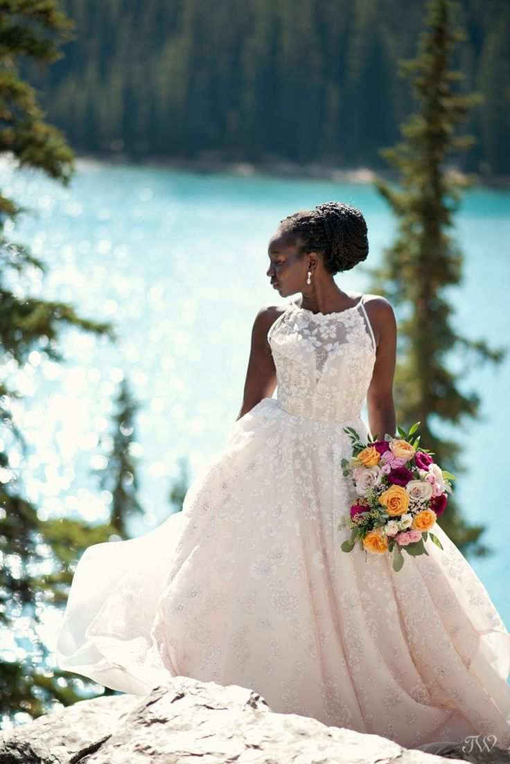 Moraine Lake bride Debol above the lake captured by Tara Whittaker Photography | Reagan gown by Hayley Paige