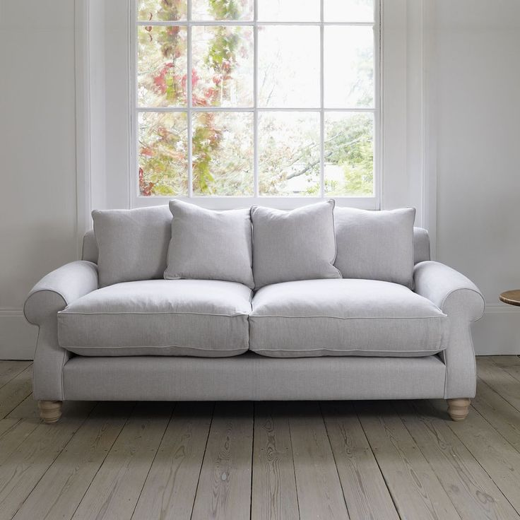 The Elgin sofa has a more fitted feeling with the lovely oak feet on show.